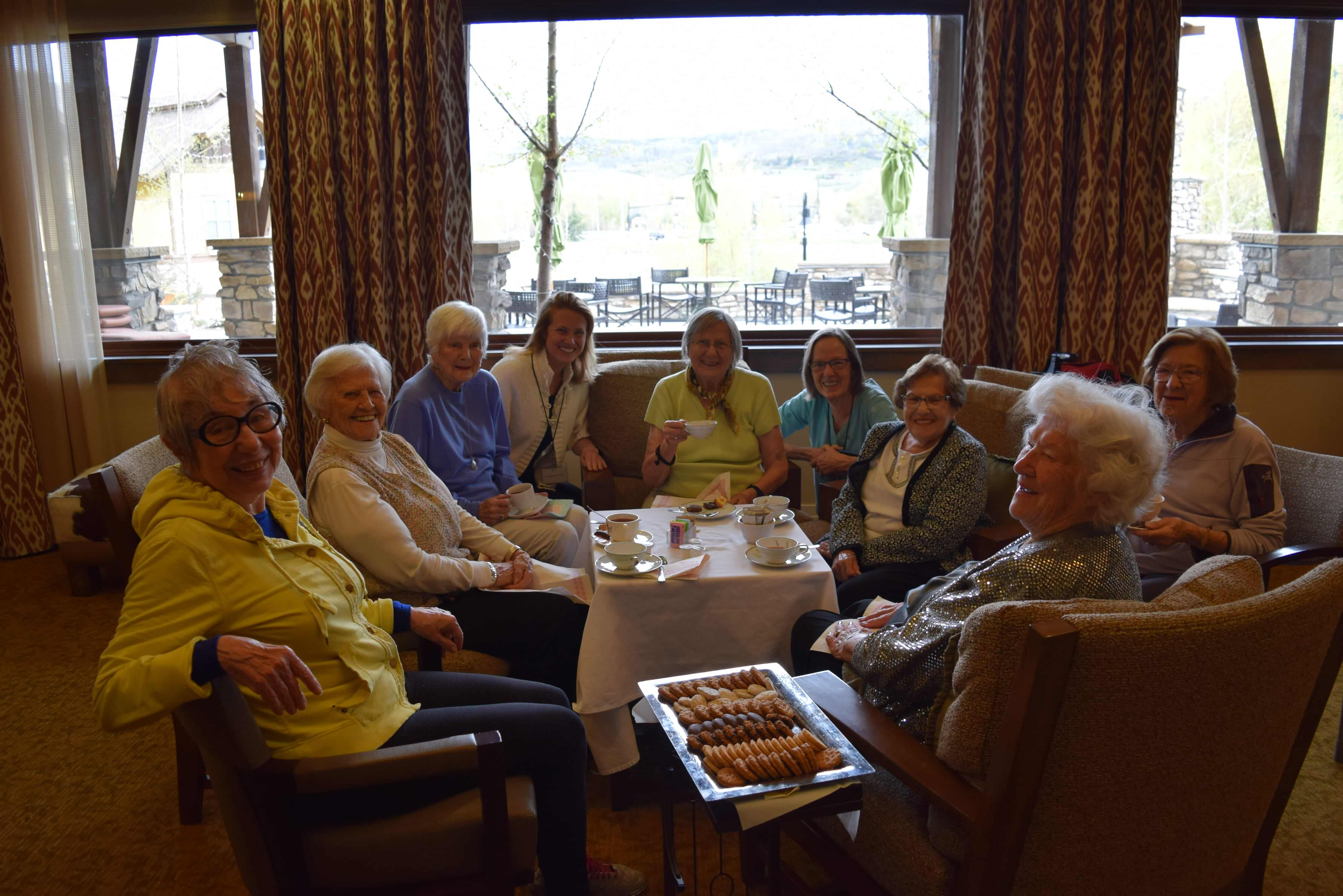 seniors talking having drinks and food
