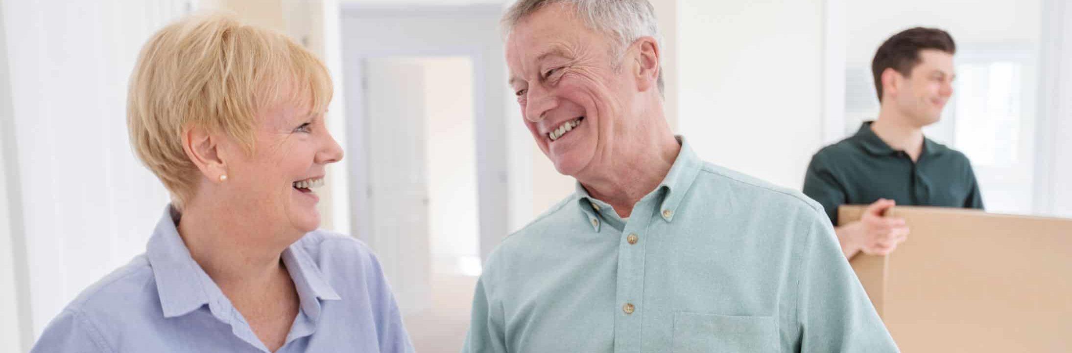 smiling seniors moving